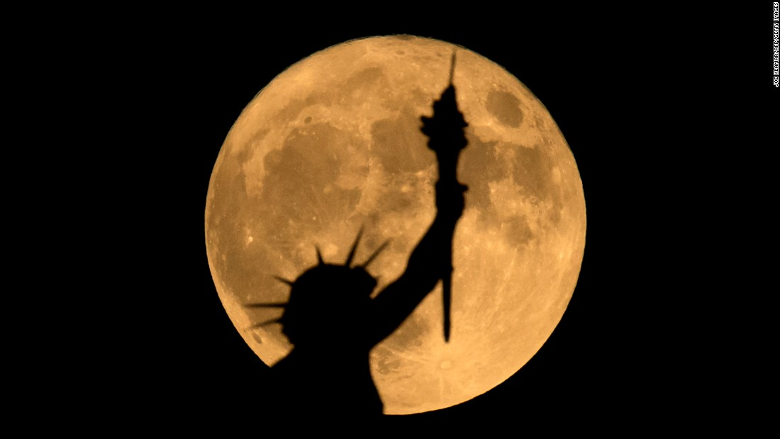 The supermoon is seen above a statue in Vienna, Austria, on November 14.