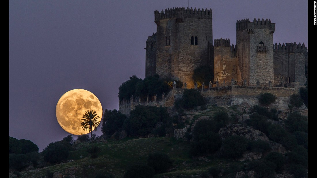 The moon rises behind the Almodovar castle in Cordoba, Spain, on Sunday, November 13.