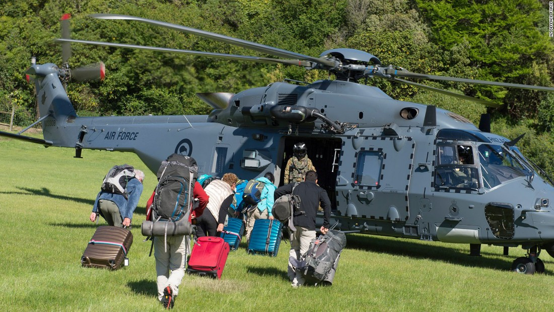 The New Zealand Defence Force conducts airlifts to evacuate people trapped in the area of Kaikoura after landslides cut off roads to the town.