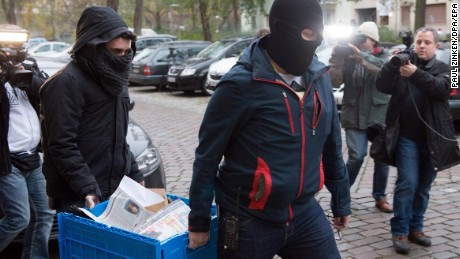 Police officers seize evidence in a raid on The True Religion Islamist organization in Berlin on Tuesday.