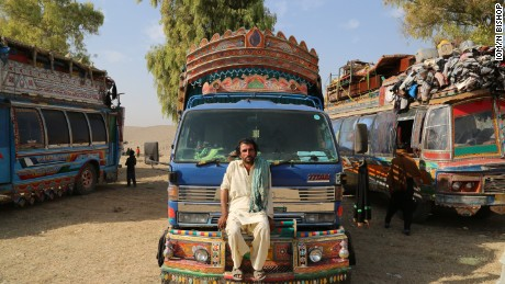 Mohammad Akhbar poses on his rented truck at a UNHCR camp in Nangarhar province after making the week long journey from his home in Pakistan's Khyber Pakhtunkhwa to Afghanistan.