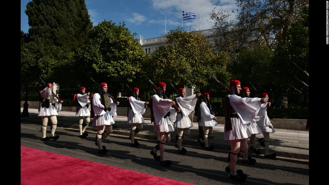 Greek presidential guards parade outside the presidential mansion in Athens on November 15.