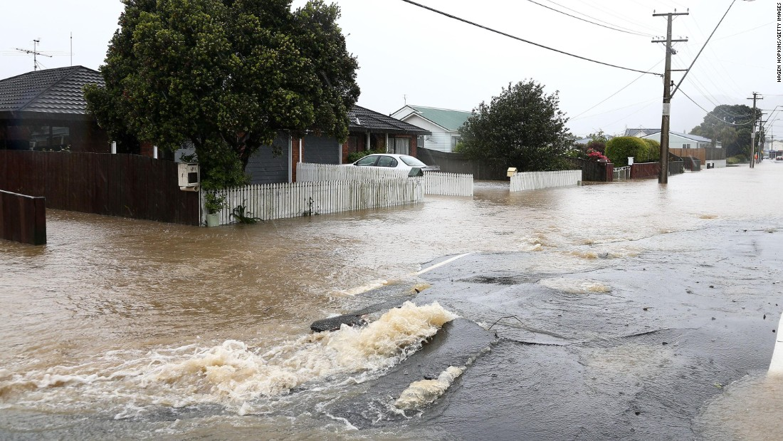 A cracked street is flooded in the area of Petone, near Wellington, after severe weather impacted the region in the aftermath of the quake on November 15. Two people were killed in the quake, which was followed by more than 1,000 aftershocks.