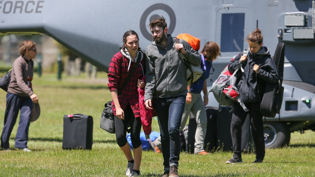 Tourists who had been visiting Kaikoura disembark from a military helicopter in Christchurch on November 15.