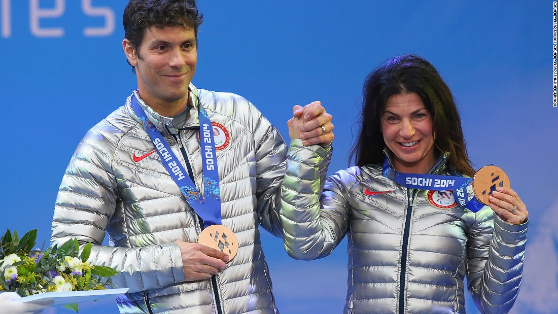 Danelle lost all useable vision in her right eye at 13, and at 27, she lost central vision in her left eye. Pictured here, Danelle and Rob with their bronze medals at the Sochi 2014 Paralympic Winter Games.