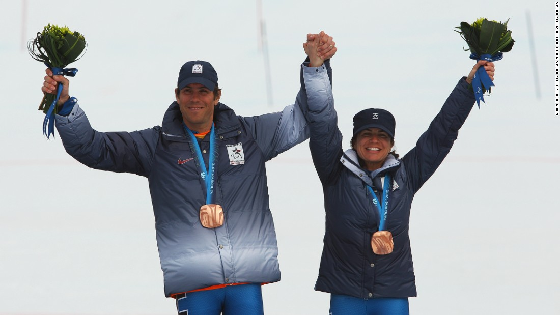 Pictured, Danelle and Rob at the medal ceremony for the Women's Visually Impaired Super Combined during the 2010 Vancouver Winter Paralympics.