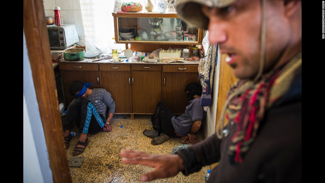 "<strong>November 11:</strong> A member of Iraq's special forces guards two suspected ISIS fighters found hiding in a house in Mosul, Iraq. An Iraqi-led offensive was launched in October <a href=""http://www.cnn.com/2016/10/17/world/gallery/mosul/index.html"" target=""_blank"">to reclaim Mosul,</a> Iraq's second-largest city and the last major stronghold for ISIS in the country."
