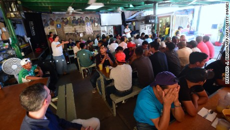 Prayers are said before a meal by deported migrants at a canteen run by BorderLinks just across the US-Mexico border in Nogales, Sonora, Mexico on October 11, 2016.  BorderLinks is a nonprofit organization based in Tucson, Arizona that connects people to the reality of the US-Mexico Borderlands and immigrant communities in the United States. / AFP / Frederic J. BROWN        (Photo credit should read FREDERIC J. BROWN/AFP/Getty Images)