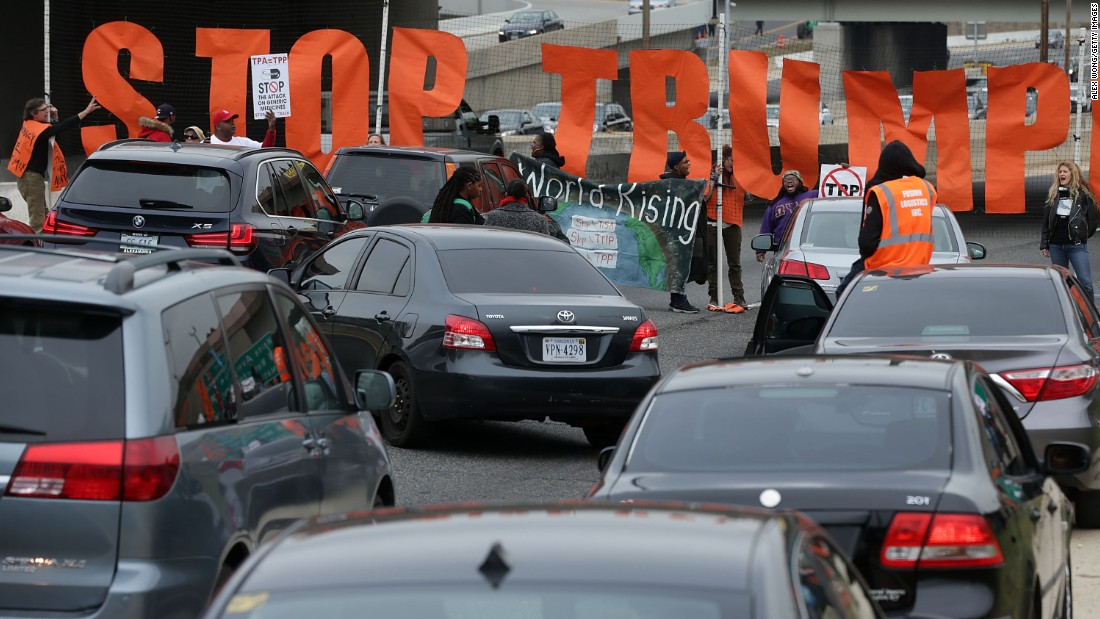 Activists use a banner to block traffic on Interstate 395 during an anti-Trump protest in Washington on Monday, November 14.