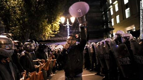 Police face off against demonstrators Tuesday during an anti-capitalist protest in Athens.