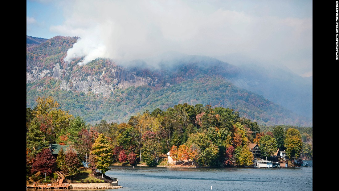 Smoke from the Party Rock fire spreads near Lake Lure on Wednesday, November 9.
