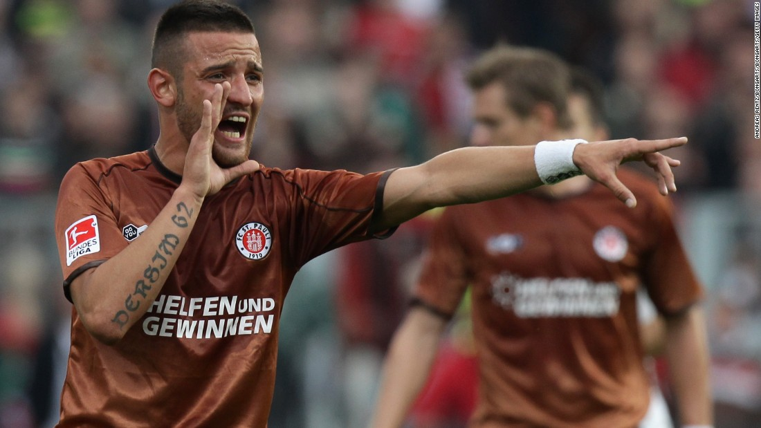 German footballer Deniz Naki -- shown playing for former club St. Pauli of the Bundesliga -- was banned for 12 matches and fined $5,825 for a Facebook post dedicating his Turkish second division club's victory to Kurdish combatants in southeastern Turkey. Naki's parents are of Kurdish origin, and he has Kurdish-themed tattoos on his arms.