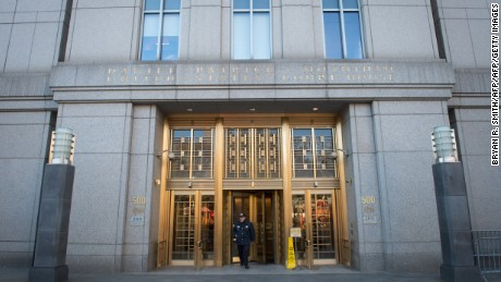 "An officer stands guard at the entrance to the US Federal Courthouse November 12, 2015 in New York. US agents arrested two nephews of Venezuela's first lady,Cilia Flores, for allegedly conspiring to smuggle 800 kilos (1,800 pounds) of cocaine into America. Efrain Antonio Campo Flores and Francisco Flores de Freitas were arrested in Haiti on November 10, 2015 by local police, handed over to US agents and flown the same day to New York, the newspaper said, citing two unnamed people ""familiar with the matter.""The two men are due to appear before a US federal judge in New York  November 12, 2015.  AFP PHOTO/DON EMMERT        (Photo credit should read DON EMMERT/AFP/Getty Images)"