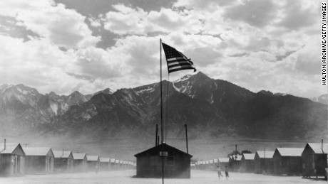 A US flag flies at a Japanese-American internment camp, circa 1942