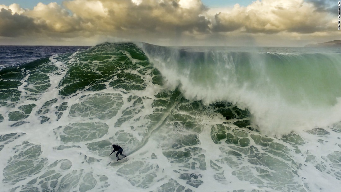 British surfer Andrew Cotton hopes to ride the biggest wave in history, ideally in previously untouched waters.