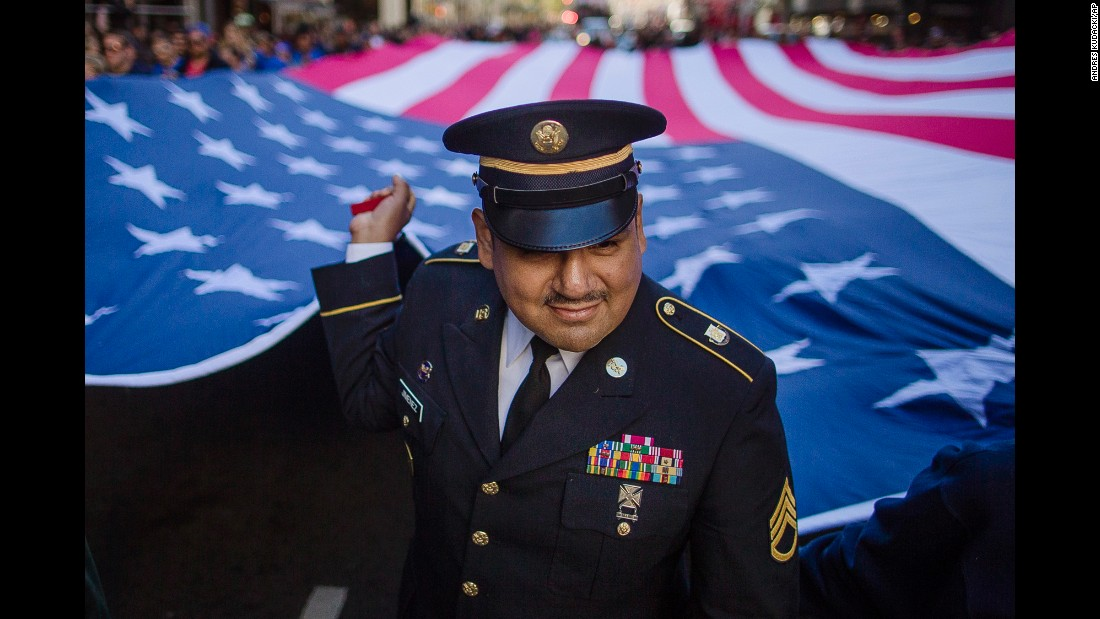 "Military personnel hold an American flag during New York's annual <a href=""http://www.cnn.com/2016/11/11/world/gallery/veterans-day-2016/index.html"" target=""_blank"">Veterans Day</a> parade on Friday, November 11."
