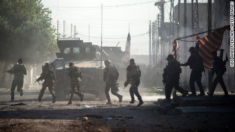 Iraqi soldiers come under fire from ISIS fighters as they try to push forward in Karkukli, Mosul.