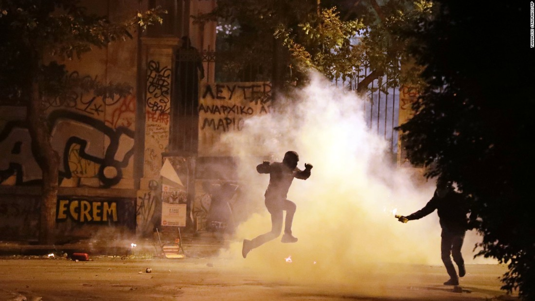 "A protester jumps to avoid tear gas during an anti-capitalism protest in Athens, Greece, on Tuesday, November 15. <a href=""http://www.cnn.com/2016/11/16/europe/greece-athens-obama-protests/"" target=""_blank"">Six people were arrested</a> after a group of anarchists started throwing rocks and Molotov cocktails, Athens police told CNN."