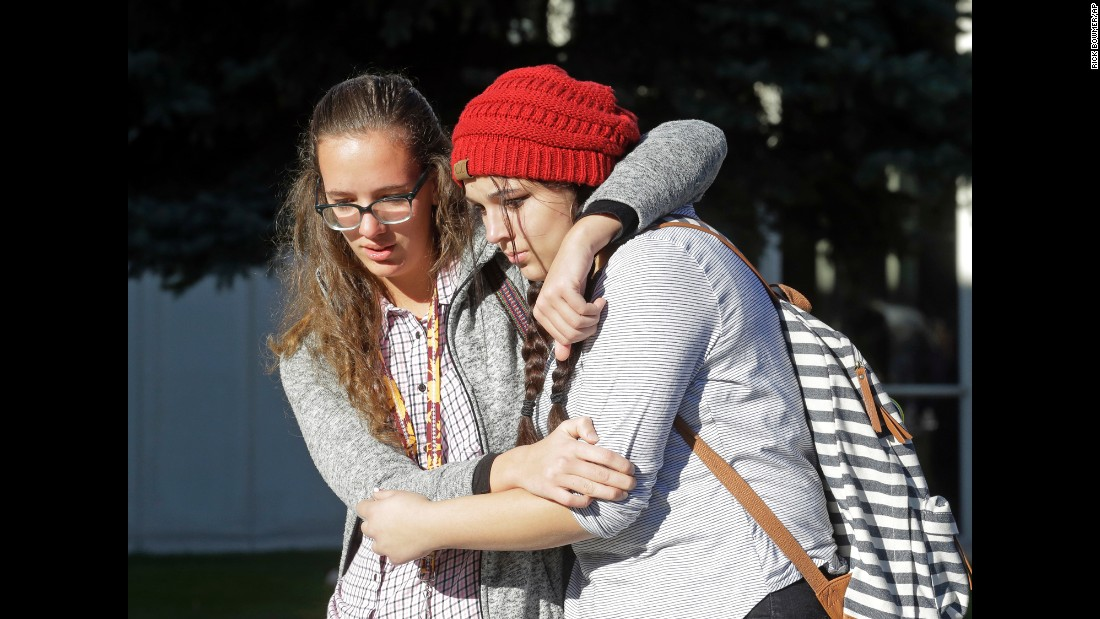 "Students Holly Hilton, left, and Albany Cox leave a high school in Orem, Utah, after several students were stabbed there on Tuesday, November 15. Police said a 16-year-old boy was taken into custody after the stabbings. All victims <a href=""http://www.sltrib.com/home/4588326-155/police-report-stabbing-at-mountain-view"" target=""_blank"">were expected to survive.</a>"