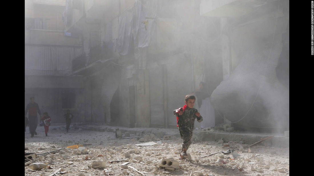 "A child walks through smoke after airstrikes in Aleppo, Syria, on Wednesday, November 16. Rebels took control of eastern Aleppo in 2014, and government forces <a href=""http://www.cnn.com/2016/11/17/middleeast/syria-aleppo-airstrikes-bombs/"" target=""_blank"">have besieged the area, </a>battering it from above with the help of Russian air power."