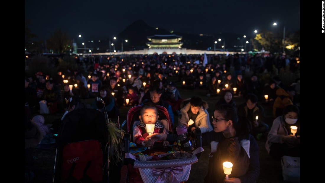 "Demonstrators hold candles during an anti-government protest in Seoul, South Korea, on Saturday, November 12. Hundreds of thousands of people <a href=""http://www.cnn.com/2016/11/12/asia/south-korean-protest-president-park/"" target=""_blank"">took to the streets</a> to call for President Park Geun-hye's resignation. Park's opposition has grown following her unprecedented admission that she shared classified information with someone who lacked the necessary security clearance. <a href=""http://www.cnn.com/2016/11/10/world/gallery/week-in-photos-1111/index.html"" target=""_blank"">See last week in 35 photos</a>"