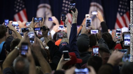 MANASSAS, VA - DECEMBER 02:  Supporters hold up their phone cameras as they wait for the arrival of Republican presidential candidate Donald Trump at a campaign rally December 2, 2015 in Manassas, Virginia. Trump continued to campaign for the Republican nomination for U.S. President.  (Photo by Alex Wong/Getty Images)