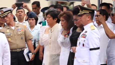 "Marcos family members, including his children, Ferdinand ""Bongbong"" Marcos and Imee Marcos, and his widow Imelda Marcos (in black) attend the ceremony."