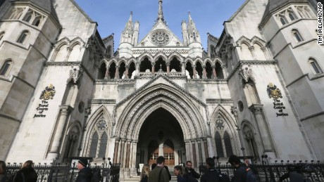 FILE - In this Thursday Nov. 3, 2016 file photo media gather outside the High Court in London. High Court Judge Peter Jackson has granted the final wishes of a 14-year-old girl to be cryogenically preserved, in what he called the first case of its kind in England — and possibly the world. (AP Photo/Tim Ireland, File)