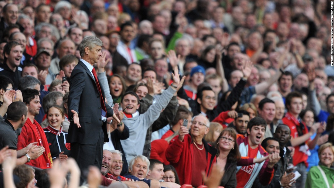 The 2009 clash at Old Trafford created one of the most iconic images of this rivalry. Sent off by referee Mike Dean, Wenger makes his way to the stands behind the dugout. Without an obvious place to go, the Frenchman holds his arms out in Dean's direction, much to the delight of the United fans around him.