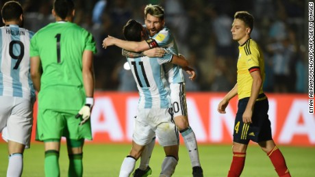 Argentina's Angel Di Maria (L) celebrates with teammate Lionel Messi after scoring against Colombia during their 2018 FIFA World Cup qualifier football match in San Juan, Argentina, on November 15, 2016. / AFP / EITAN ABRAMOVICH        (Photo credit should read EITAN ABRAMOVICH/AFP/Getty Images)