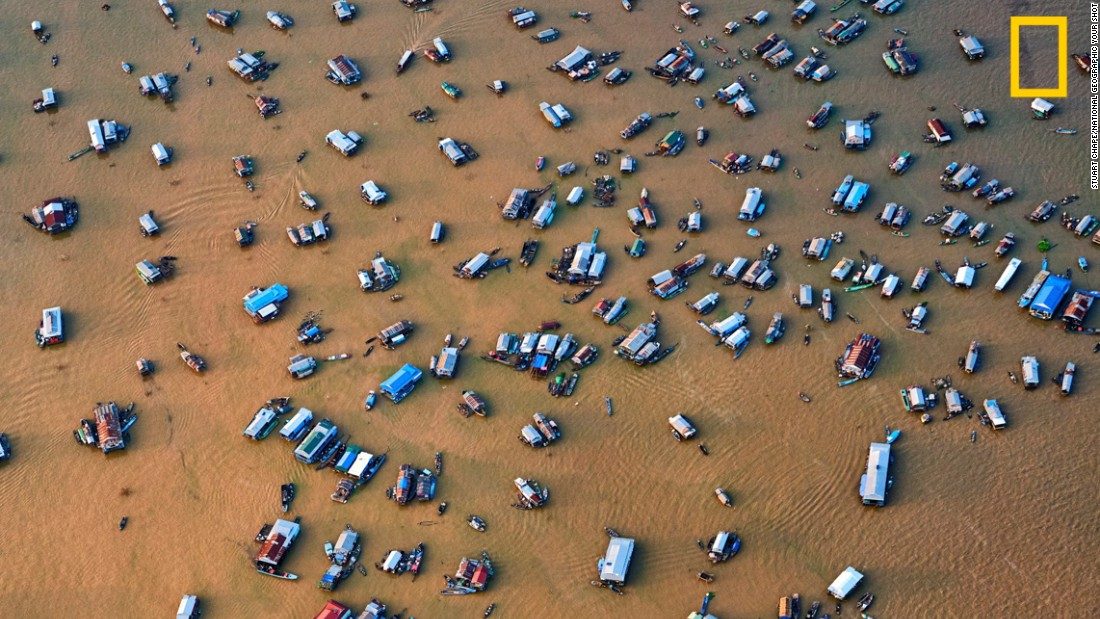 "Photo: Stuart Chape, Samoa: ""This aerial view of the Chong Kneas floating village on Tonle Sap lake, Cambodia, demonstrates just how threatened the great lake is from changing rainfall patterns and rising temperatures.""<em> <em></em>Via National Geographic Your Shot</em>"