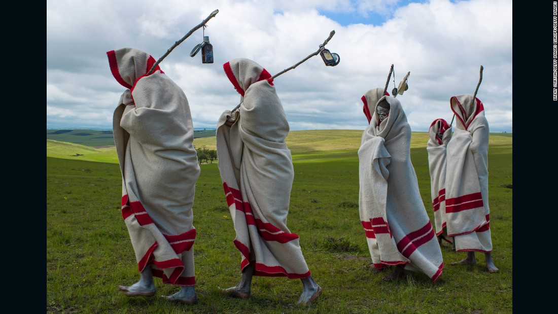 "In Eastern Cape, South Africa, young Xhosa men take part in a coming of age initiation called<em> Ulwaluko</em>. The youths, known as <em>abakhwetha</em>, are first circumcised without anesthetic, and must live in the bush with minimal supplies. Wearing white clay on their faces, initiates will fend for themselves for up to two months, living in a structure built by the village's adult community specifically for<em> Ulwaluko</em>. Upon their return they are no longer referred to as ""boy"" and receive a new blanket. The initiation has not been without its criticisms, due to <a href=""http://www.bbc.co.uk/news/world-africa-19256839"" target=""_blank"">complications and malpractice</a> surrounding the circumcision process."