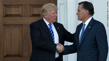 BEDMINSTER TOWNSHIP, NJ - NOVEMBER 19: (L to R) President-elect Donald Trump shakes hands with Mitt Romney after their meeting at Trump International Golf Club, November 19, 2016 in Bedminster Township, New Jersey. Trump and his transition team are in the process of filling cabinet and other high level positions for the new administration.  (Photo by Drew Angerer/Getty Images)