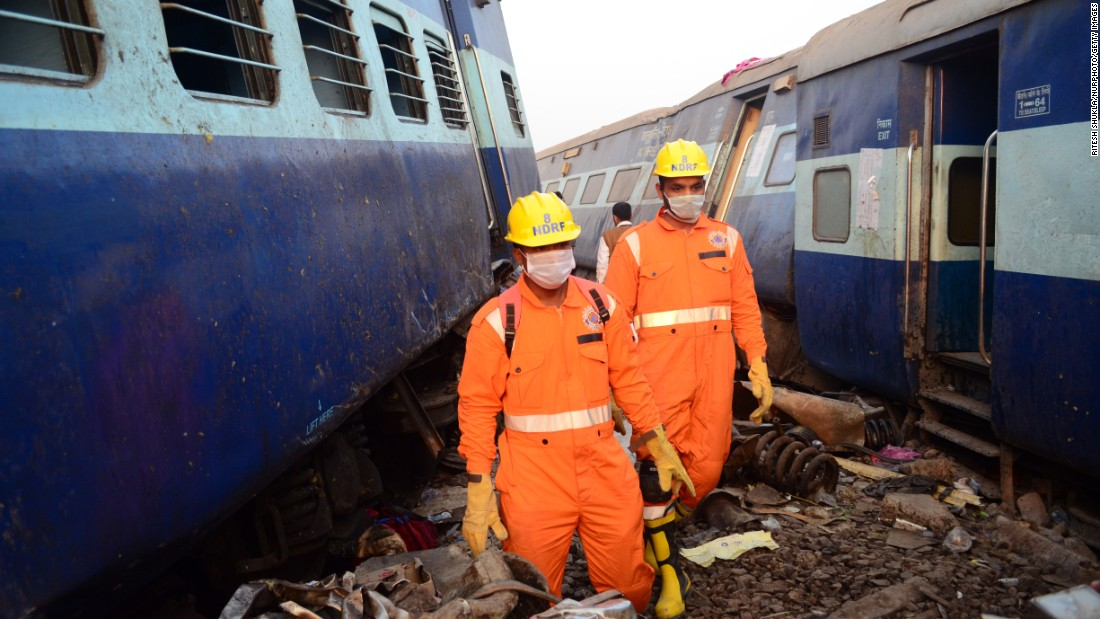 "Rescue personnel work at the site of a <a href=""http://www.cnn.com/2016/11/19/asia/indian-train-derailment-kills-dozens/index.html"">Patna-Indore Express passenger train that derailed</a> in Pukhrayan, India, near Kanpur, on Sunday, November 20. More than 100 people died in the crash."