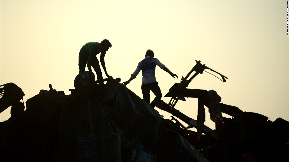 Indian rescue workers search for survivors in the wreckage.