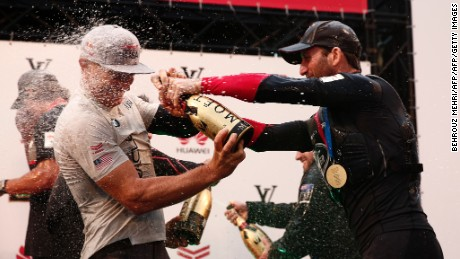 Ben Ainsley of Land Rover BAR of Great Britain (R) celebrates his team's Louis Vuitton America's Cup World series Championship with and Jimmy Spithill of Oracle Team USA (L) in Fukuoka on November 20, 2016. / AFP / Behrouz MEHRI        (Photo credit should read BEHROUZ MEHRI/AFP/Getty Images)
