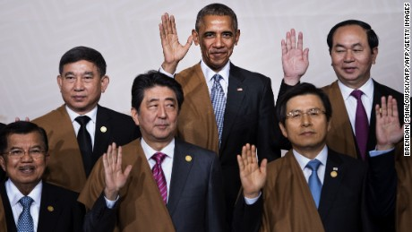 "(L to R back) Thailand's Deputy Prime Minister Prajin Juntong, US President Barack Obama and Vietnam's President Tran Dai Quang; (L to R front) Indonesia's Vice President Jusuf Kalla, Japan's Prime Minister Shinzo Abe and South Korea's Prime Minister Hwang Kyo-Ahn wave during the traditional ""family photo"" on the final day of the Asia-Pacific Economic Cooperation (APEC) Summit at the Lima Convention Centre in Lima on November 20, 2016."