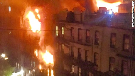 The blaze engulfed the five-story building.