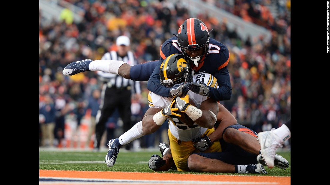 Iowa running back LeShun Daniels Jr. is tackled by Illinois defenders during a college football game in Champaign, Illinois, on Saturday, November 19. Daniels rushed for 159 yards and two touchdowns as Iowa won 28-0.