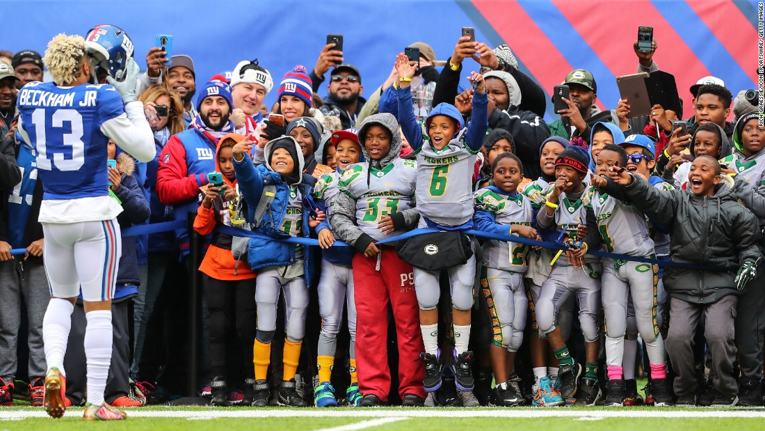Wide receiver Odell Beckham Jr. takes his helmet off for a youth football team before a New York Giants home game on Sunday, November 20.