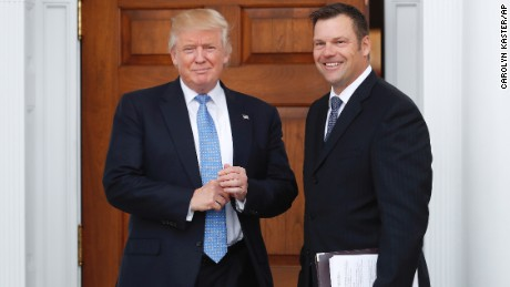 President-elect Donald Trump pauses pose for photographs as he greets Kansas Secretary of State, Kris Kobach, at the Trump National Golf Club Bedminster clubhouse, Sunday, Nov. 20, 2016, in Bedminster, N.J..