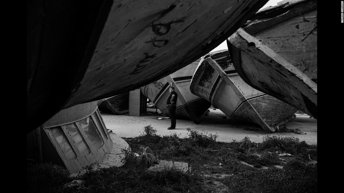 "Bartolo stands among a ""boat cemetery"" in Lampedusa. ""Even before the politics and thinking whether it is right or not if these migrants come to Italy, you should see with your own eyes the inhuman conditions in which they arrive,"" Bartolo told Schirato."