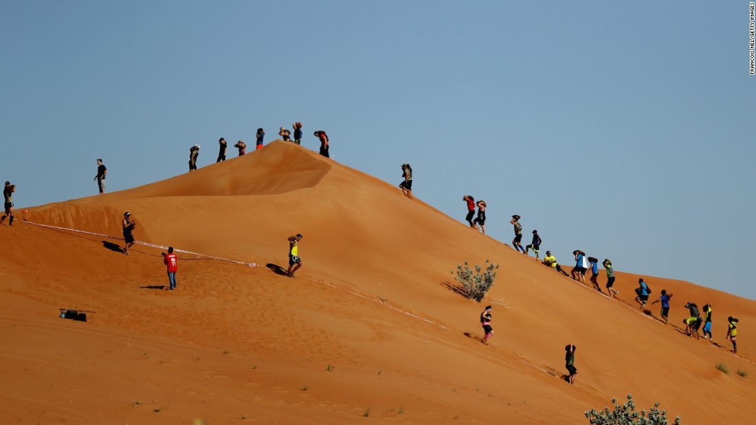 Competitors make their way across Emirati dunes during the Dubai Spartan Race on Friday, November 18.