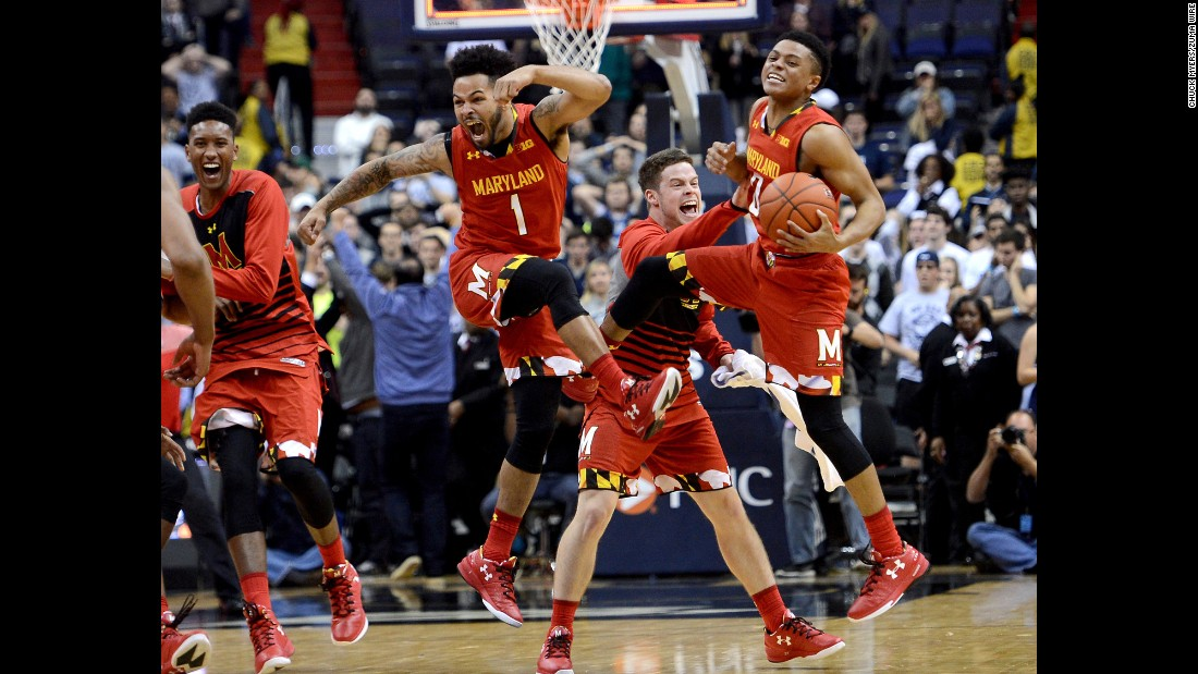 Maryland basketball players celebrate after their comeback victory against Georgetown on Tuesday, November 15.