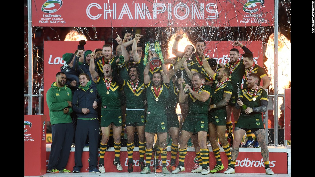 Australian rugby players celebrate after winning the Four Nations final against New Zealand on Sunday, November 20.