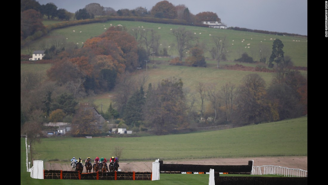 Horses compete in a hurdle race in Chepstow, Wales, on Wednesday, November 16.