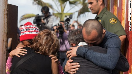 Members of the Gonzalez family hug each other and react as they encounter at the gate of the U.S.- Mexico border fence opened for a few minutes on November 19, 2016 in Playas de Tijuana, Mexico. The door opening was organized by pro-migrants NGOs and local authorities in coordination with the United States Border Patrol. / AFP / GUILLERMO ARIAS        (Photo credit should read GUILLERMO ARIAS/AFP/Getty Images)