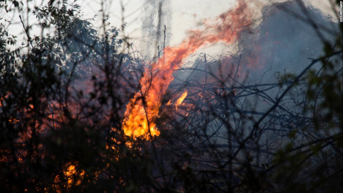 A wildfire burns in Zikhron Ya'akov on November 23.