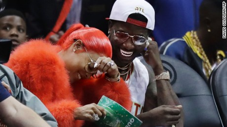 Rapper Gucci Mane surprised  Keyshia Ka'oir with a proposal during the Atlanta Hawks and the New Orleans Pelicans game in Atlanta Tuesday.