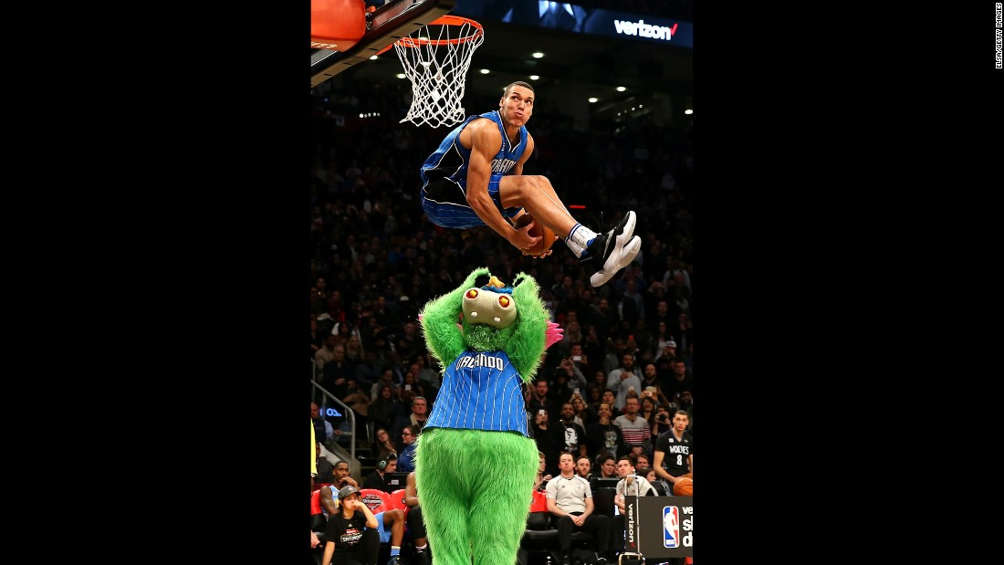 "Orlando's Aaron Gordon leaps over the team's mascot, Stuff the Magic Dragon, during the <a href=""http://www.cnn.com/2016/02/08/sport/gallery/nba-all-star-slam-dunk-champs/index.html"" target=""_blank"">NBA Slam Dunk Contest</a> on Saturday, February 13. Gordon scored a perfect 50 on the dunk, one of three 50s he had in the final round. But Zach LaVine had four and went on to win."